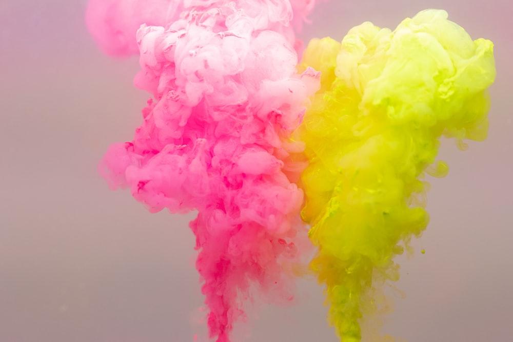 pink yellow and white smoke