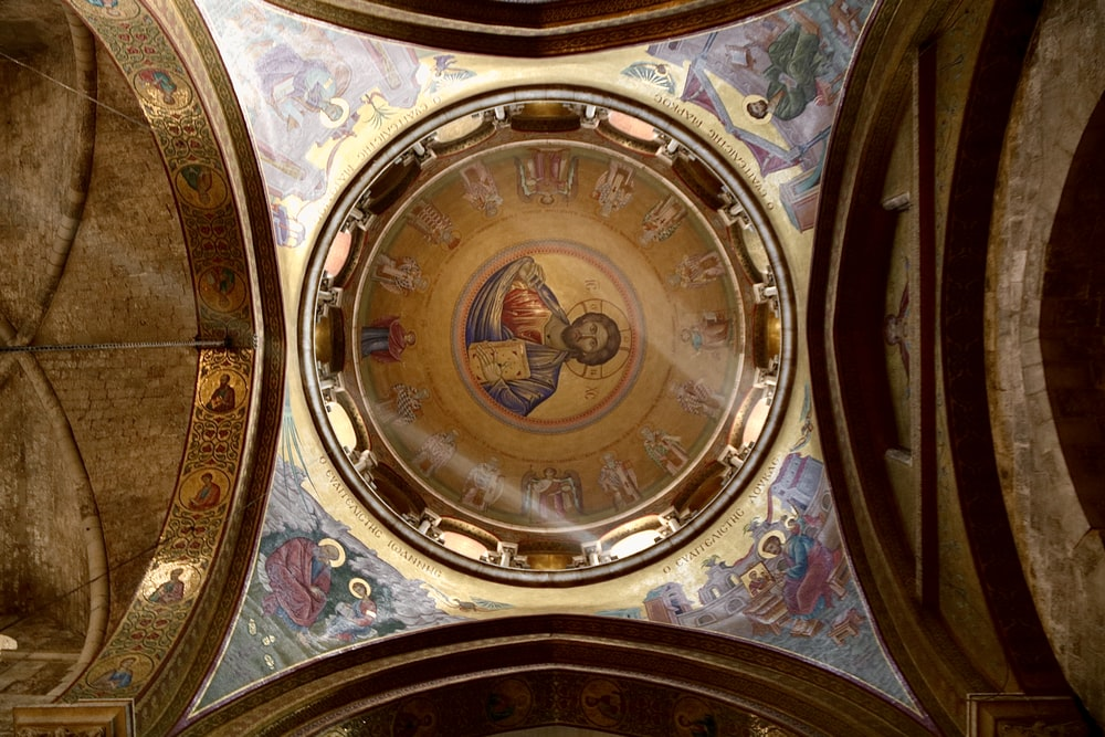 gold and blue round analog clock
