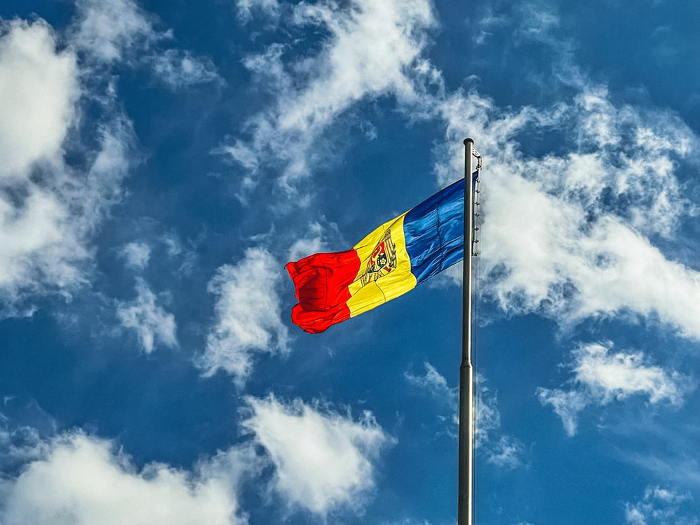red blue and yellow flag under blue sky during daytime