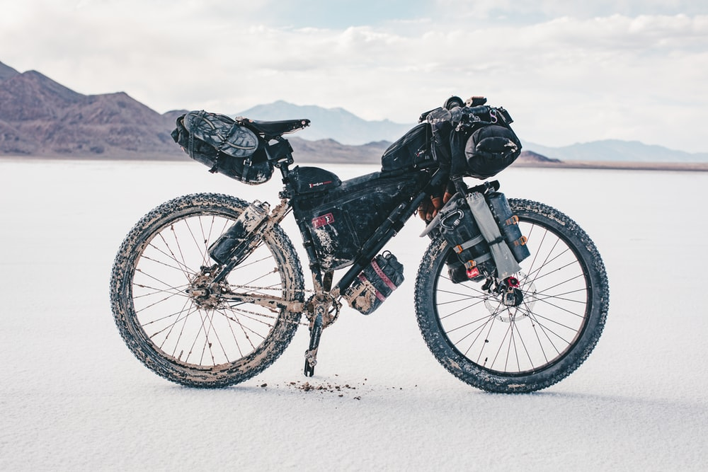 black and white mountain bike on snow covered ground