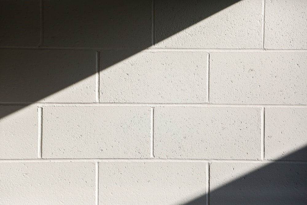 white concrete wall during daytime