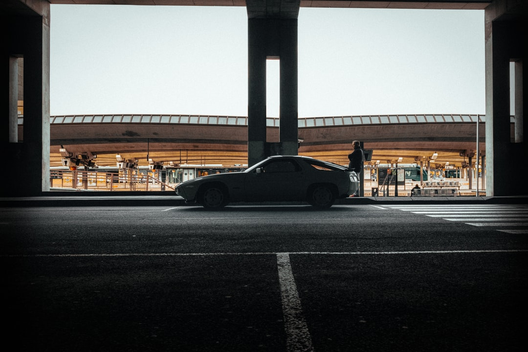 Black Coupe On Road During Daytime - unsplash