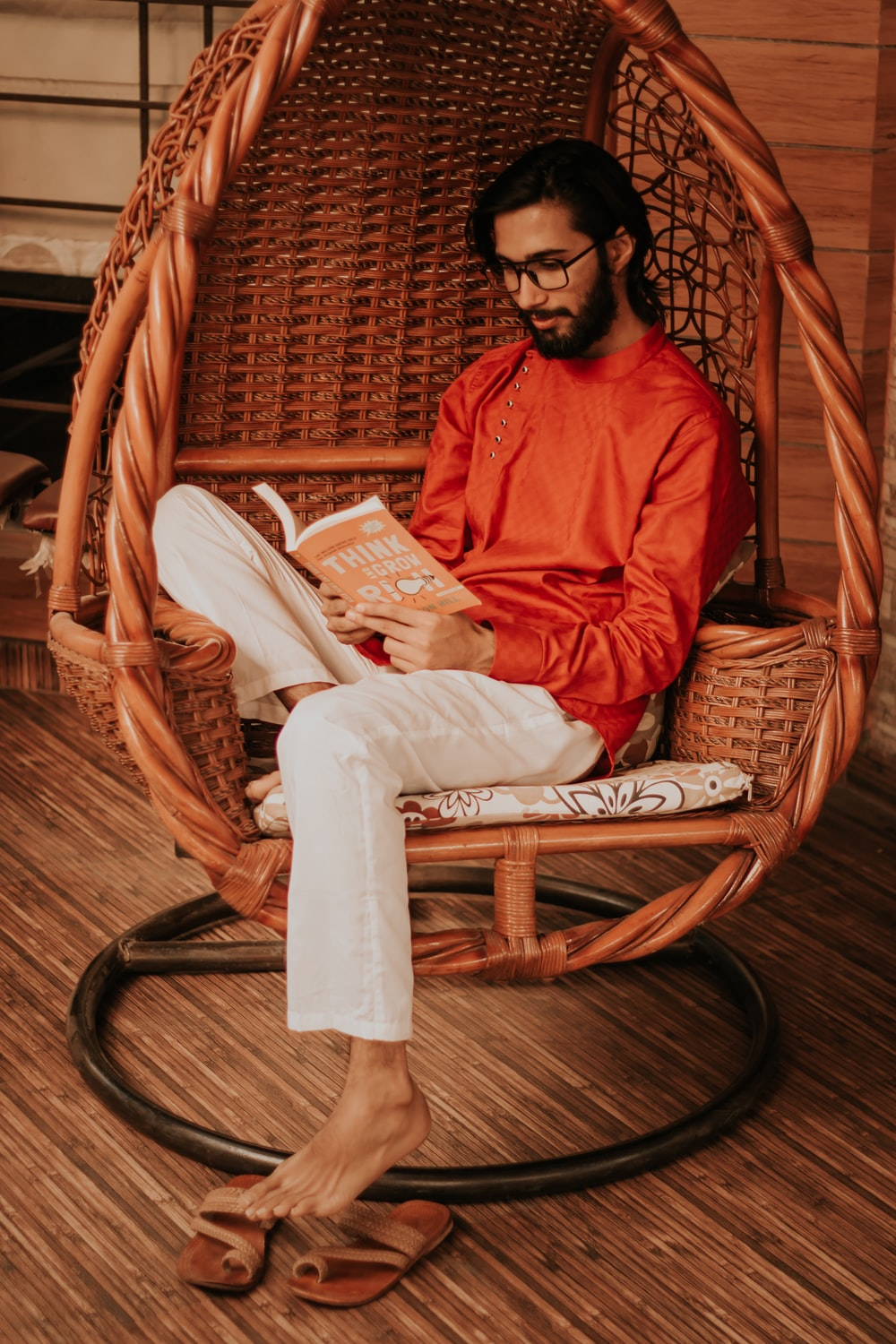 man in red long sleeve shirt reading book