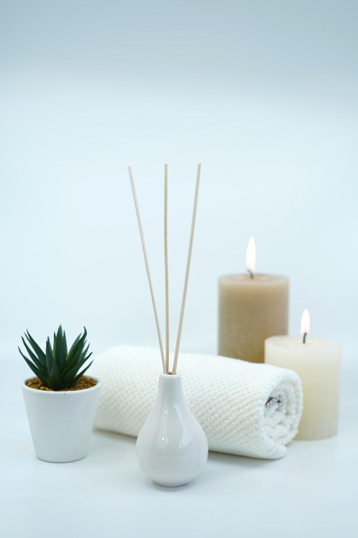 white pillar candles on white ceramic holder