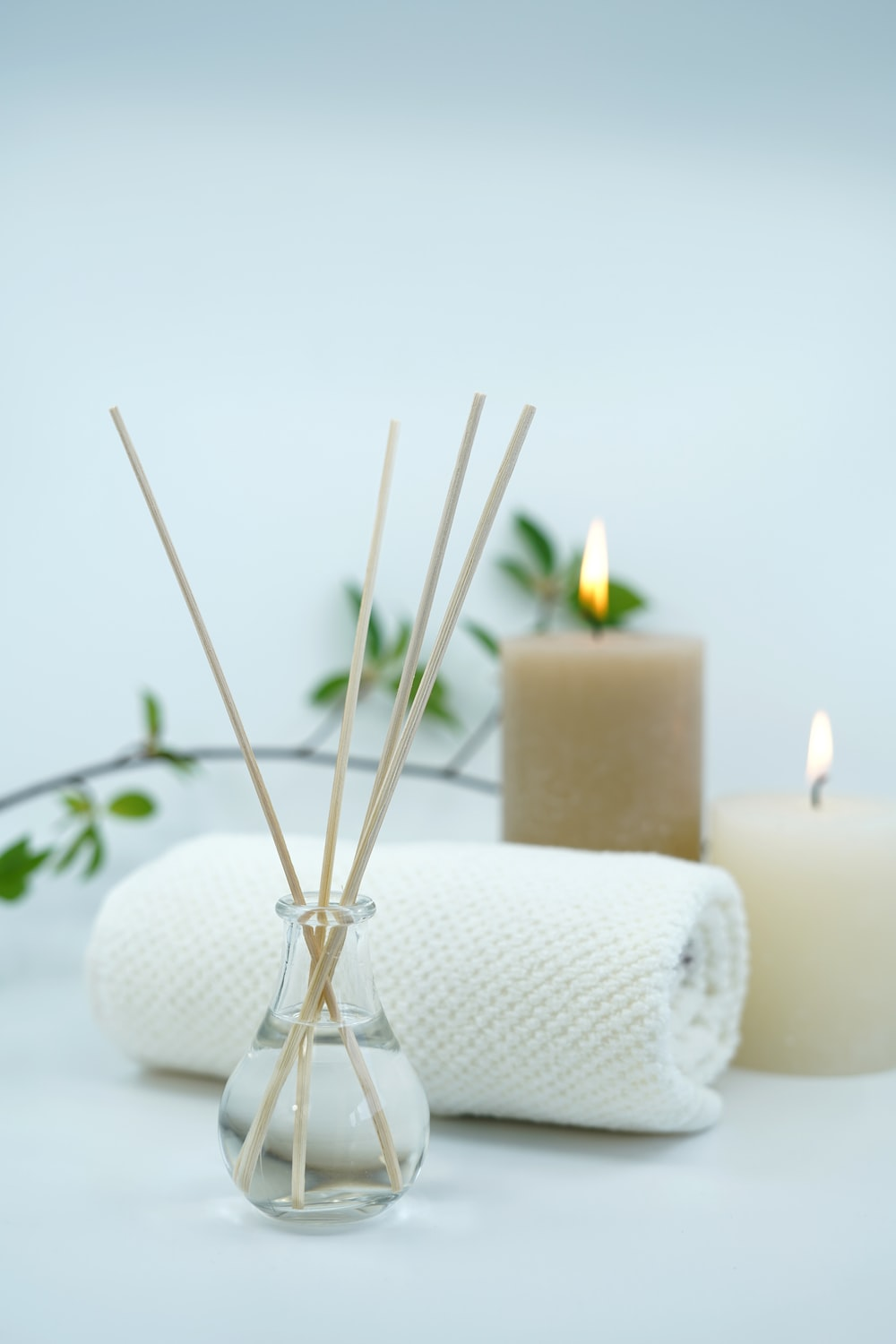white pillar candle on silver holder