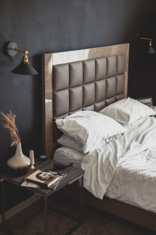 white bed linen near brown wooden nightstand