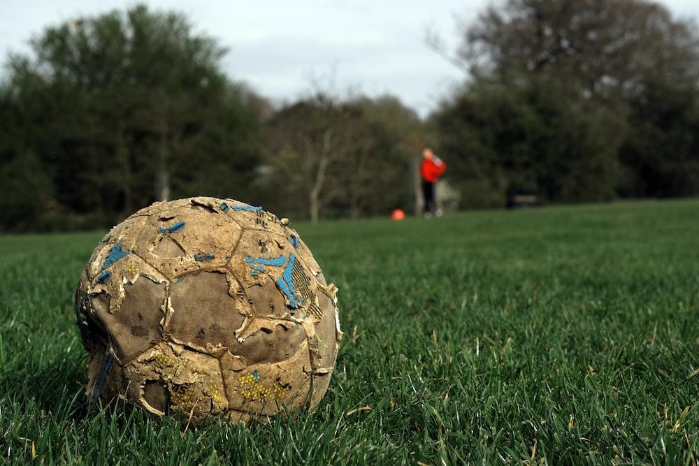 white soccer ball on green grass field during daytime