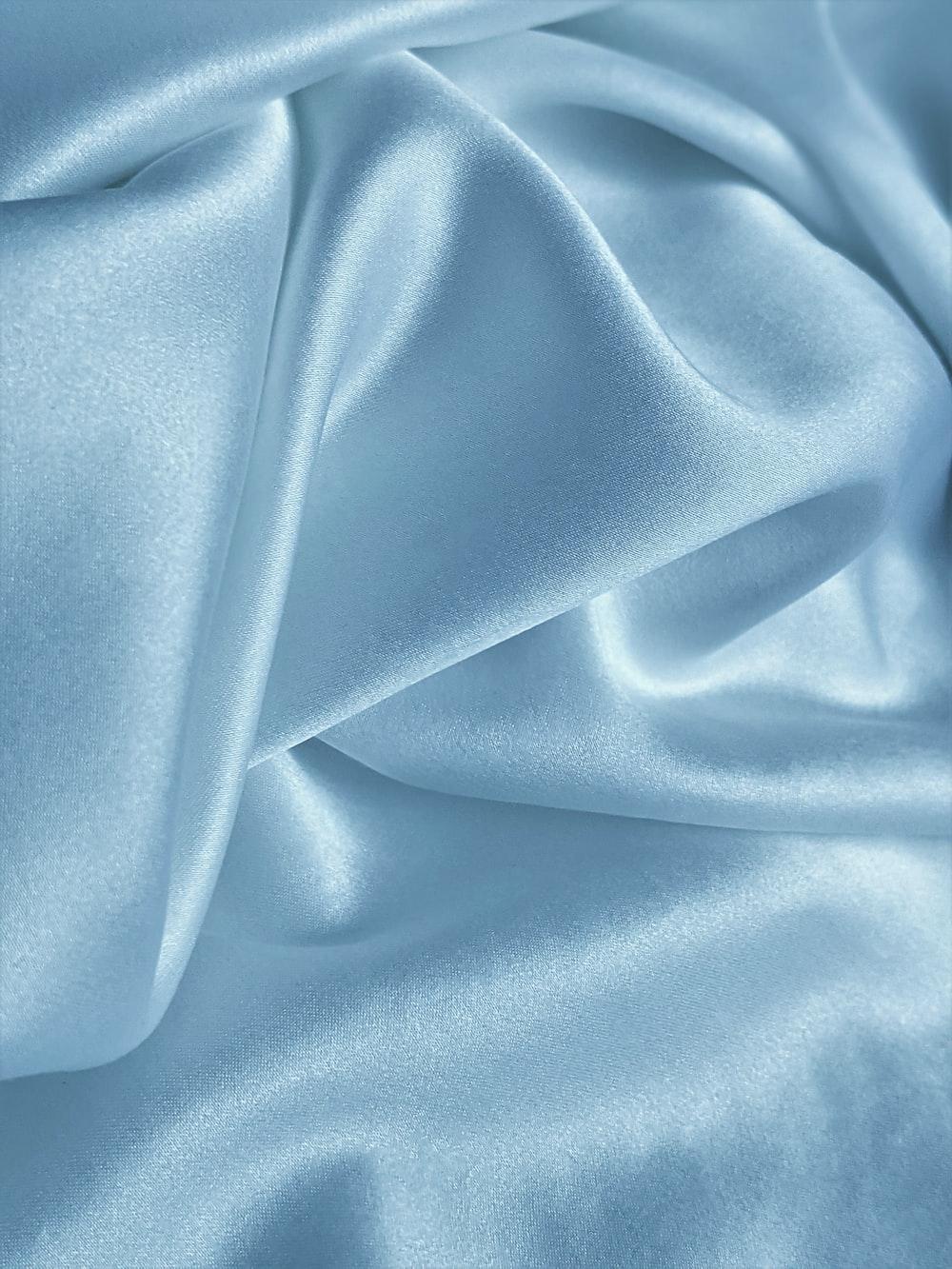 blue textile on white textile