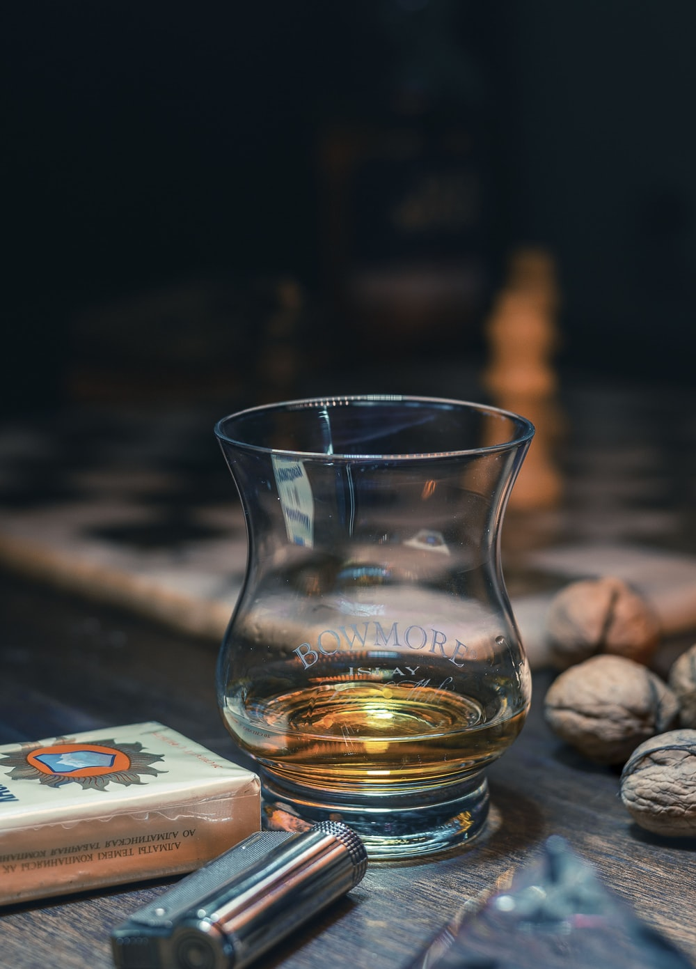 clear shot glass on brown wooden table
