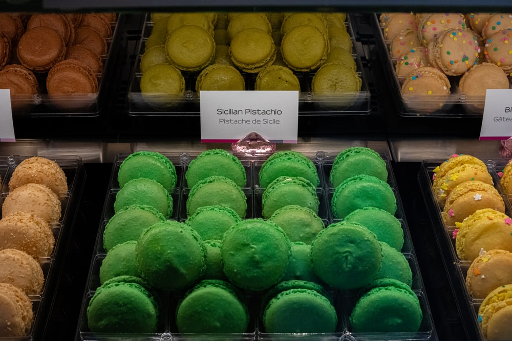 green and brown cupcakes on white metal rack