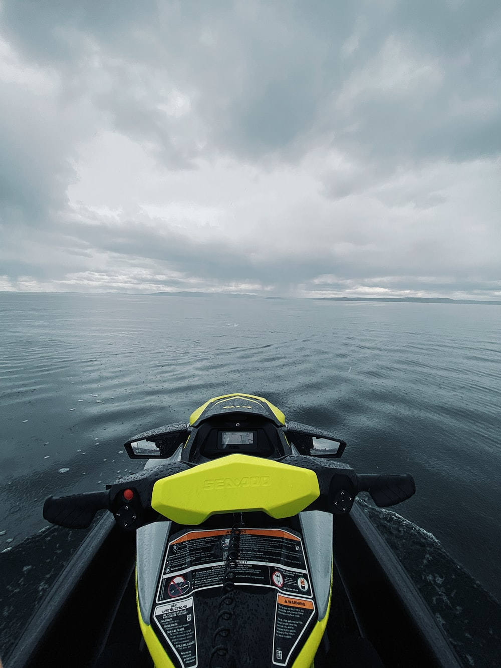 yellow and black sports car on water