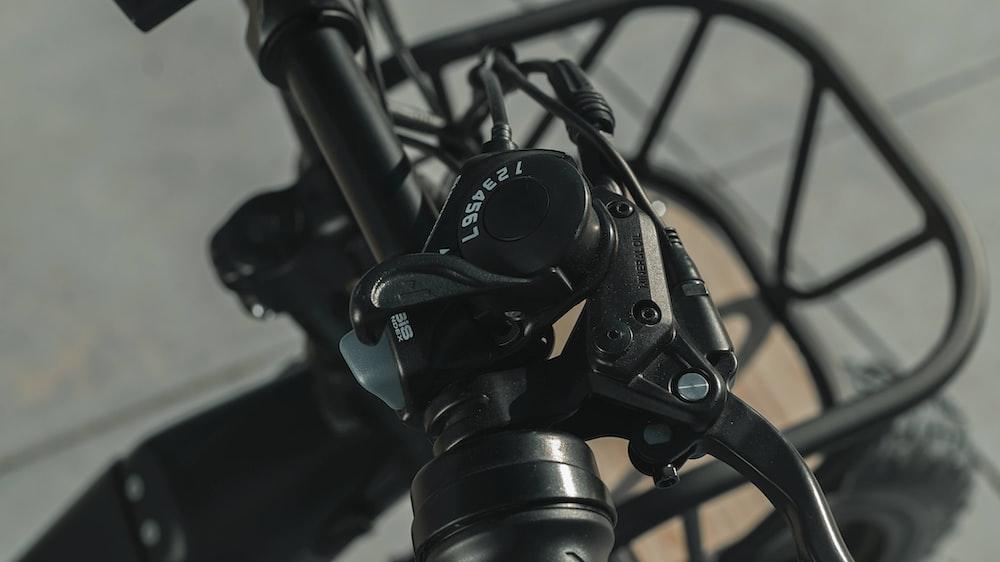 black and gray camera on black tripod