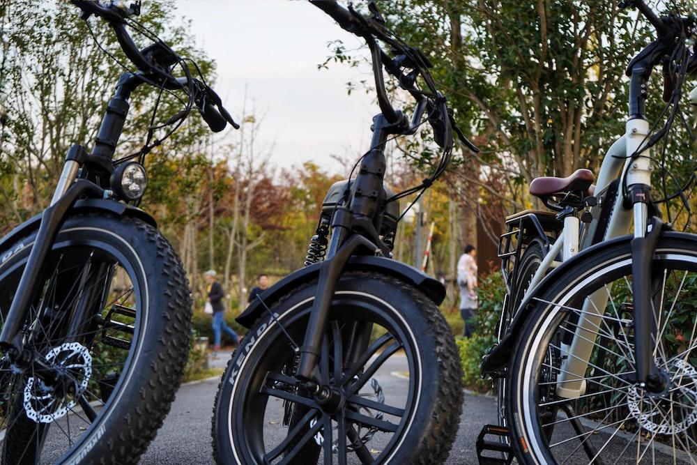 black bicycle on dirt road during daytime