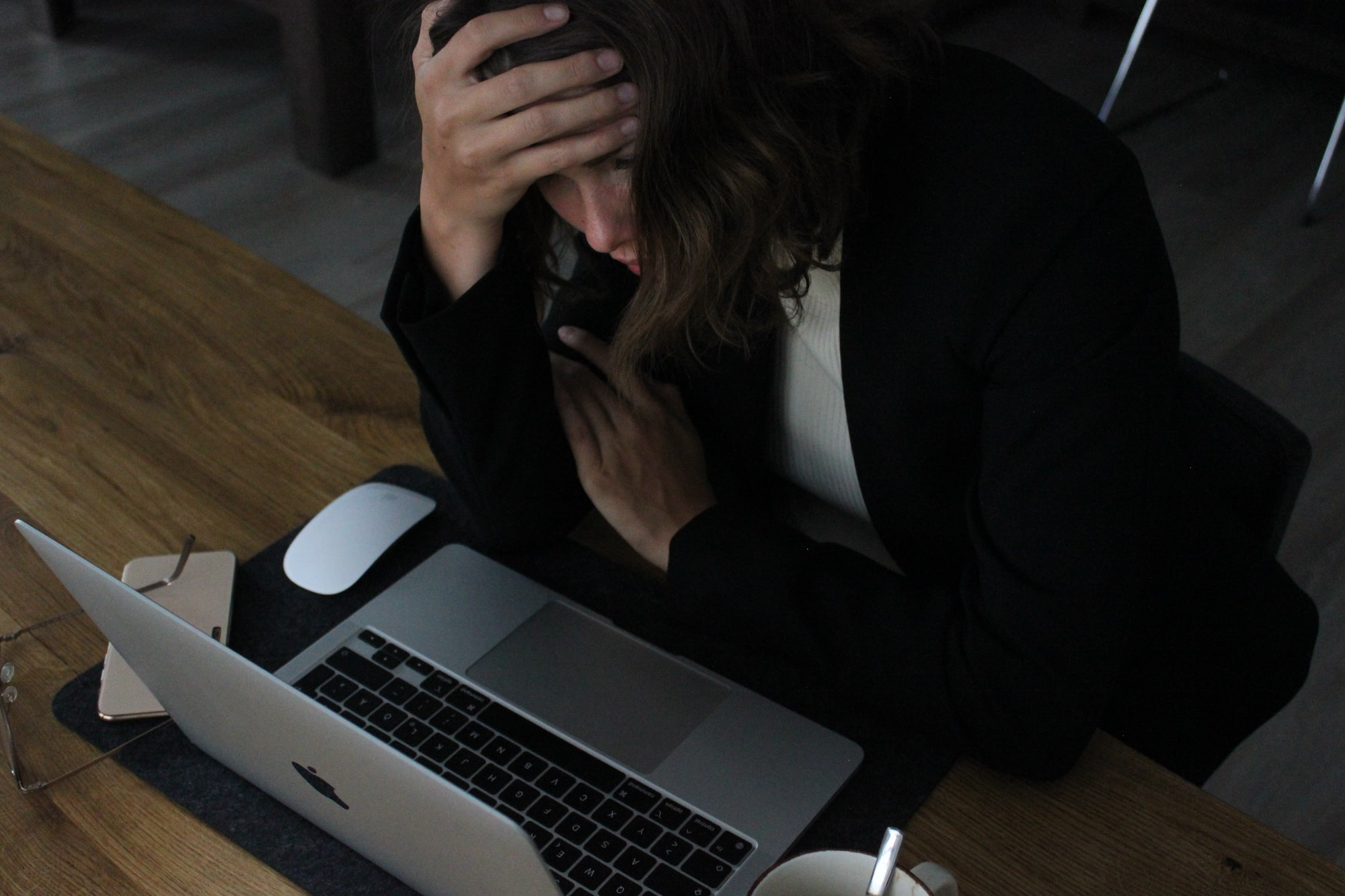 a business woman who is frustrated because she is working too much