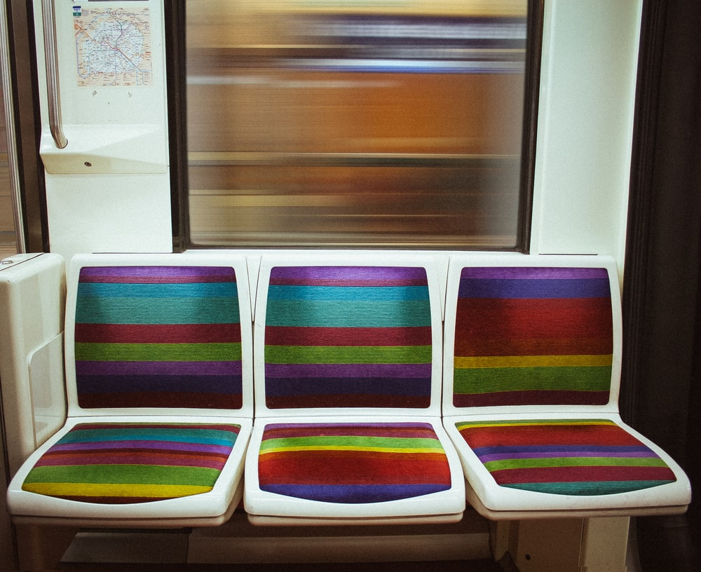 white and purple plastic chairs