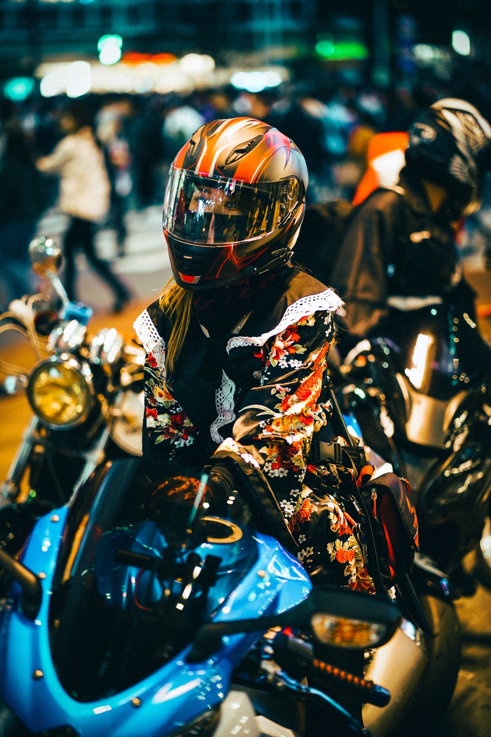 man in black and yellow motorcycle suit riding motorcycle