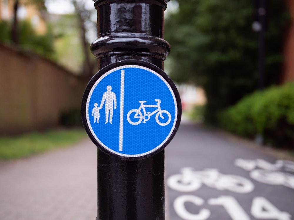 blue and black bicycle lane