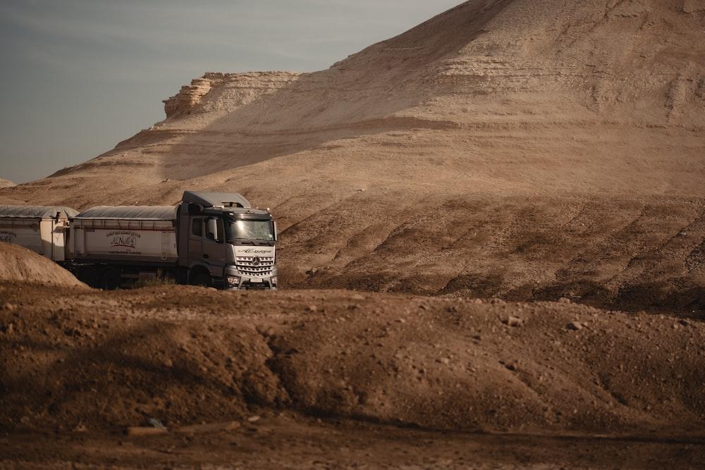 white truck on brown sand