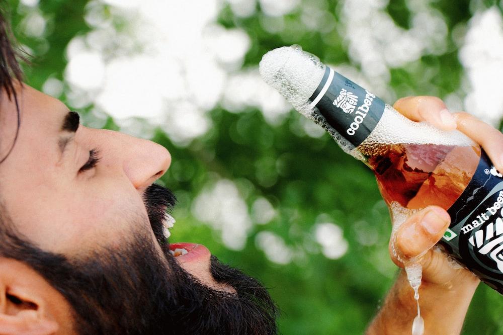 man drinking on a bottle