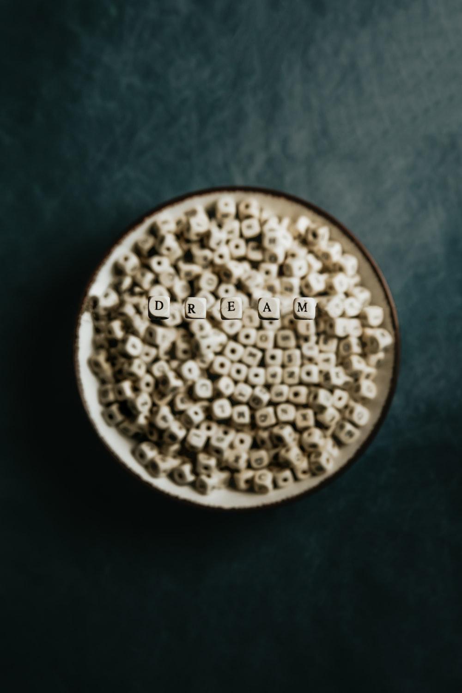 brown round beads on round white plate