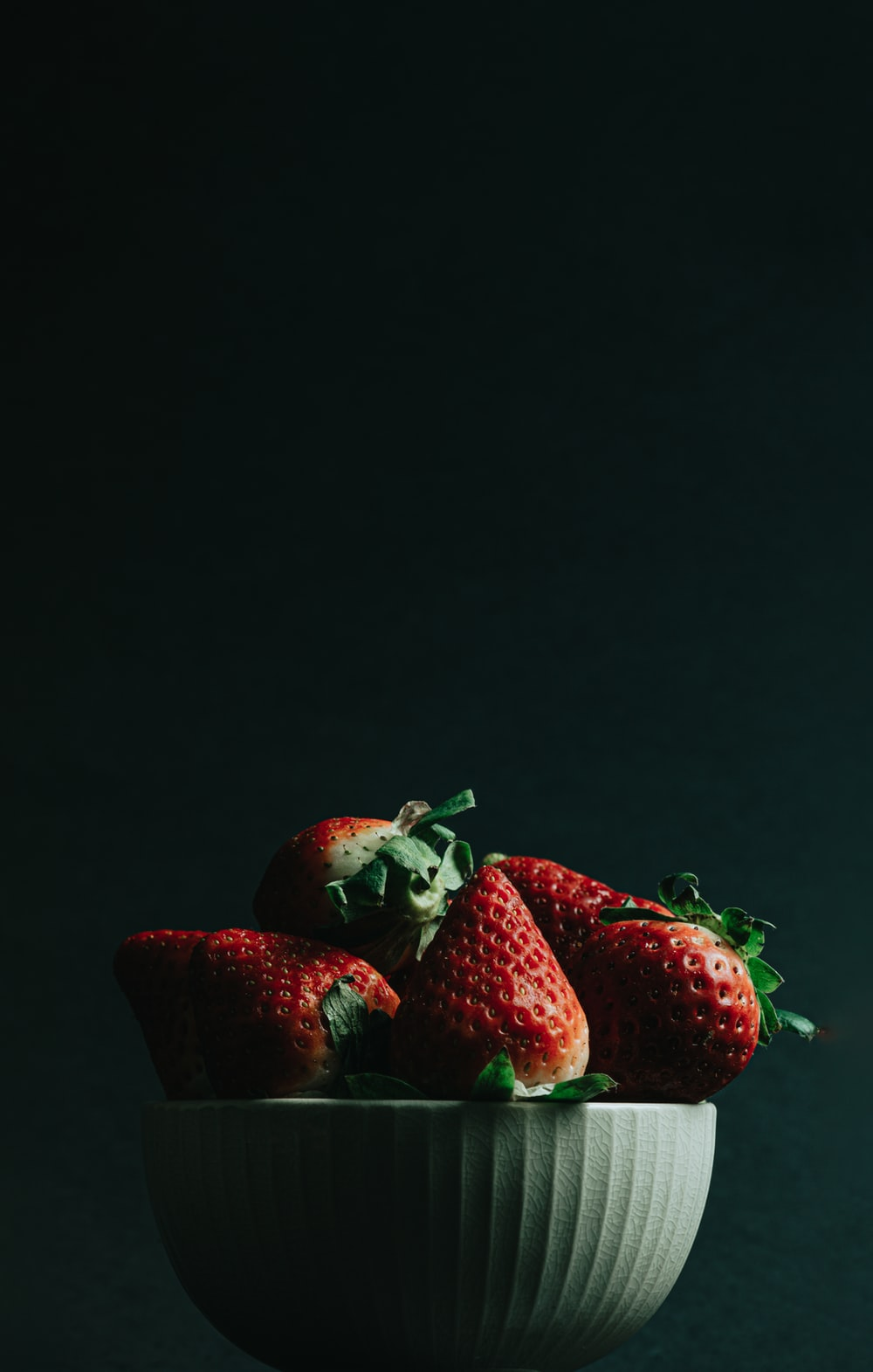 red strawberries on black surface
