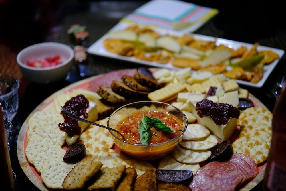 sliced bread with sliced vegetables on white ceramic plate