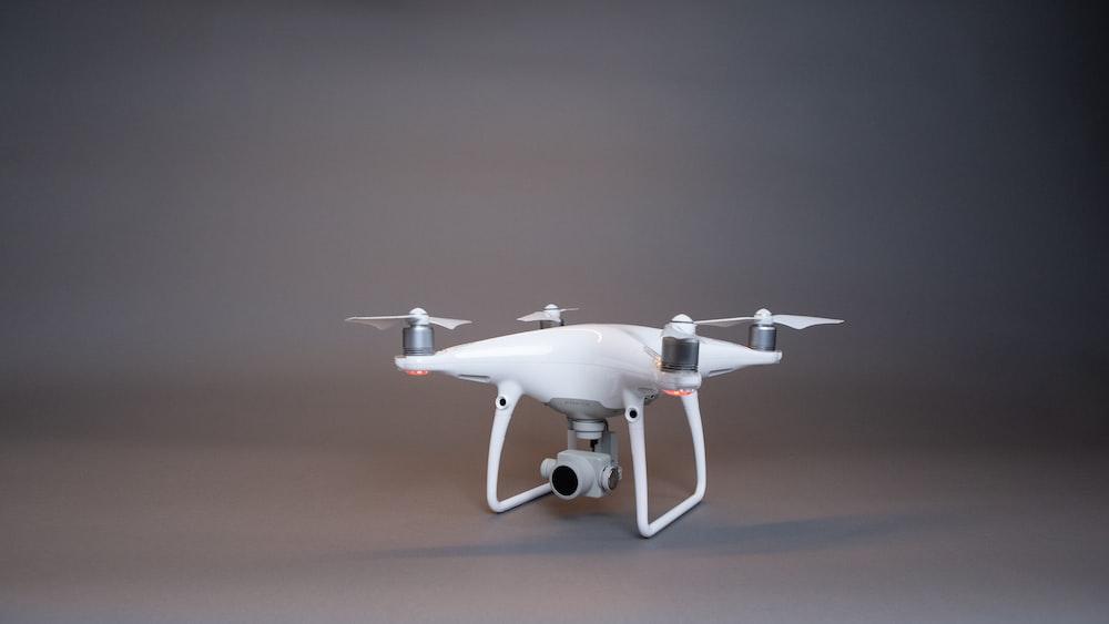 white drone on white table