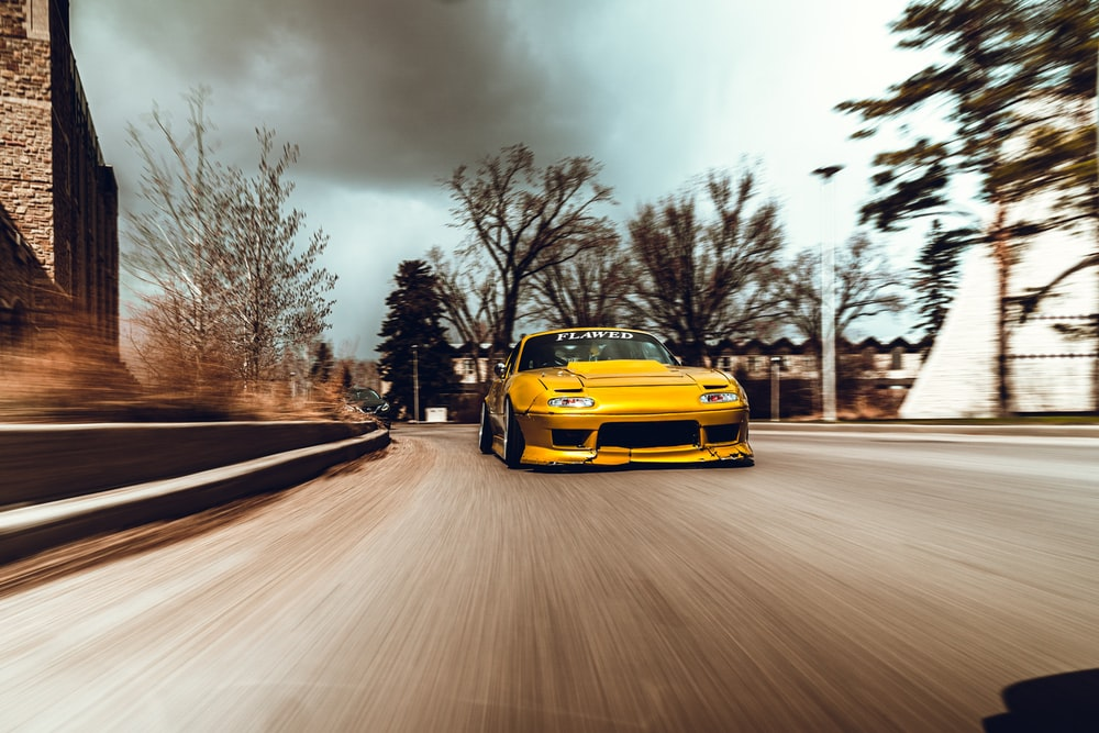 yellow car on road during daytime