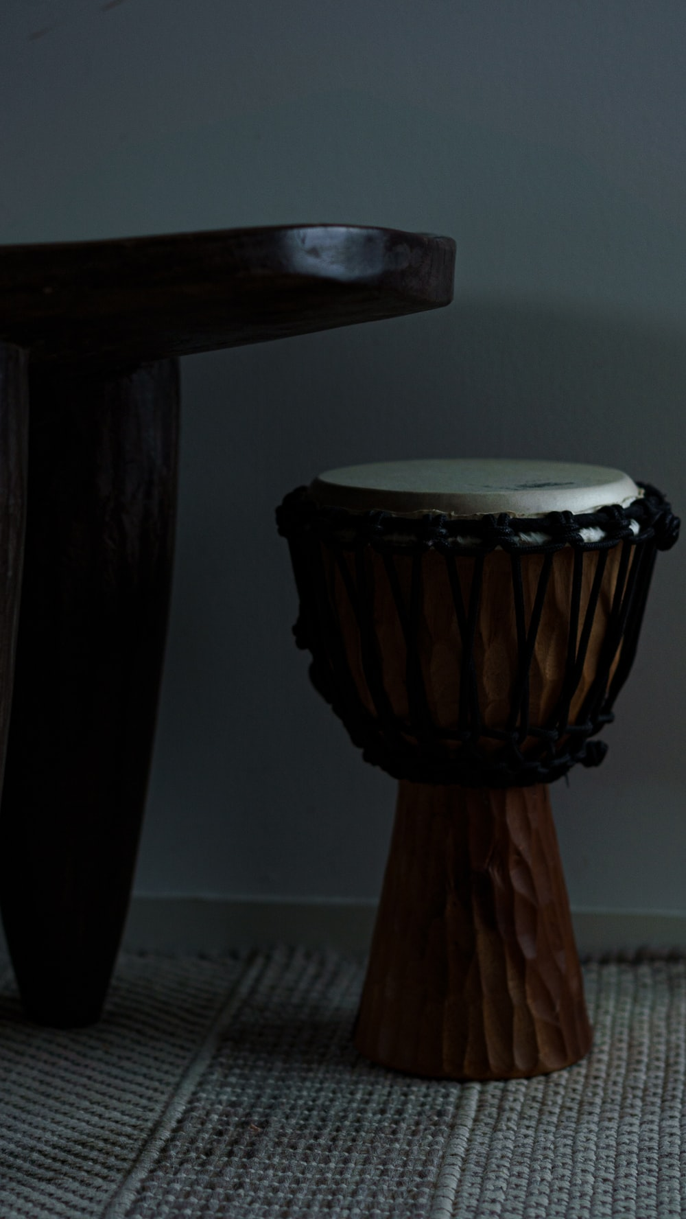black and white drum near white wall