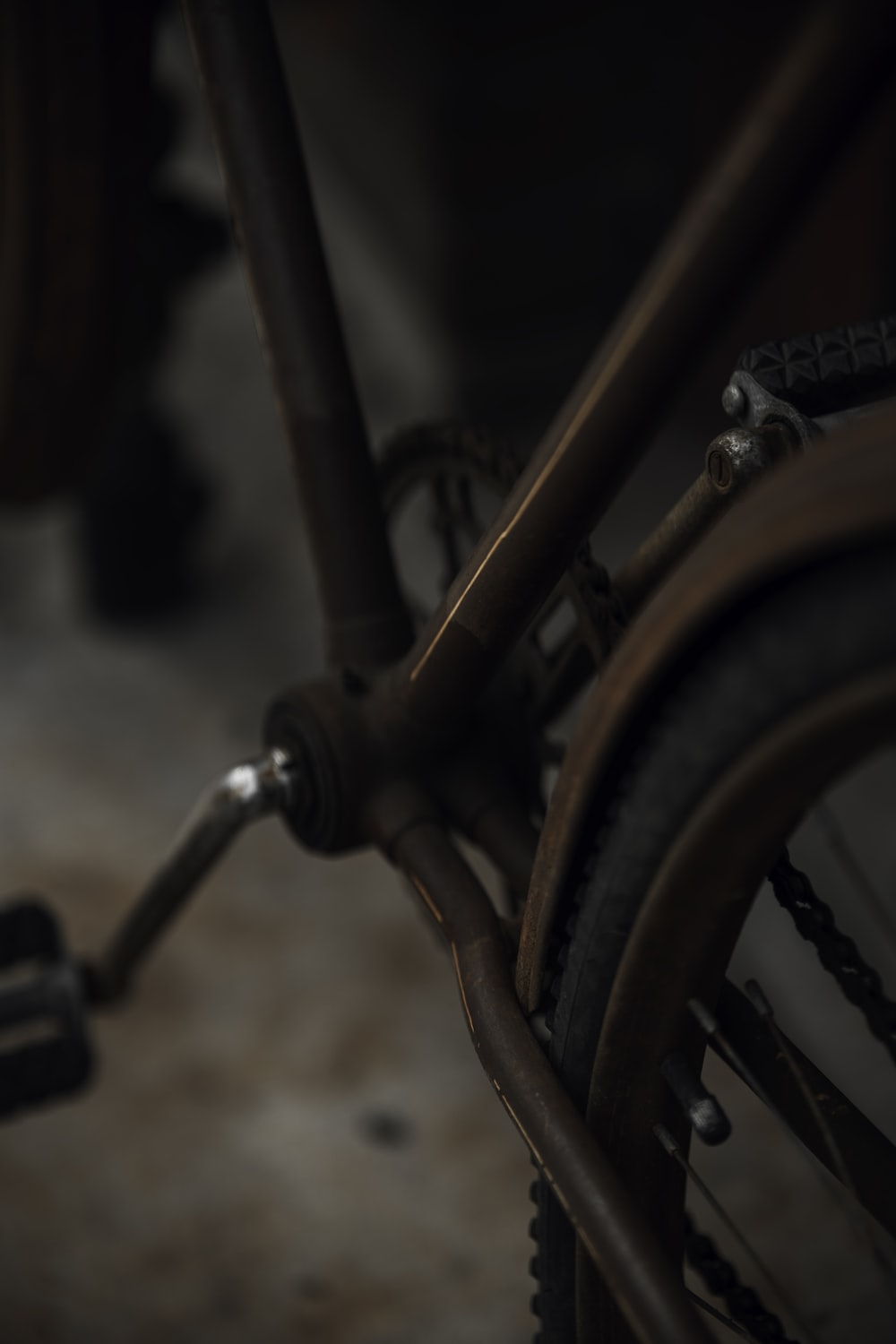 black bicycle wheel in close up photography