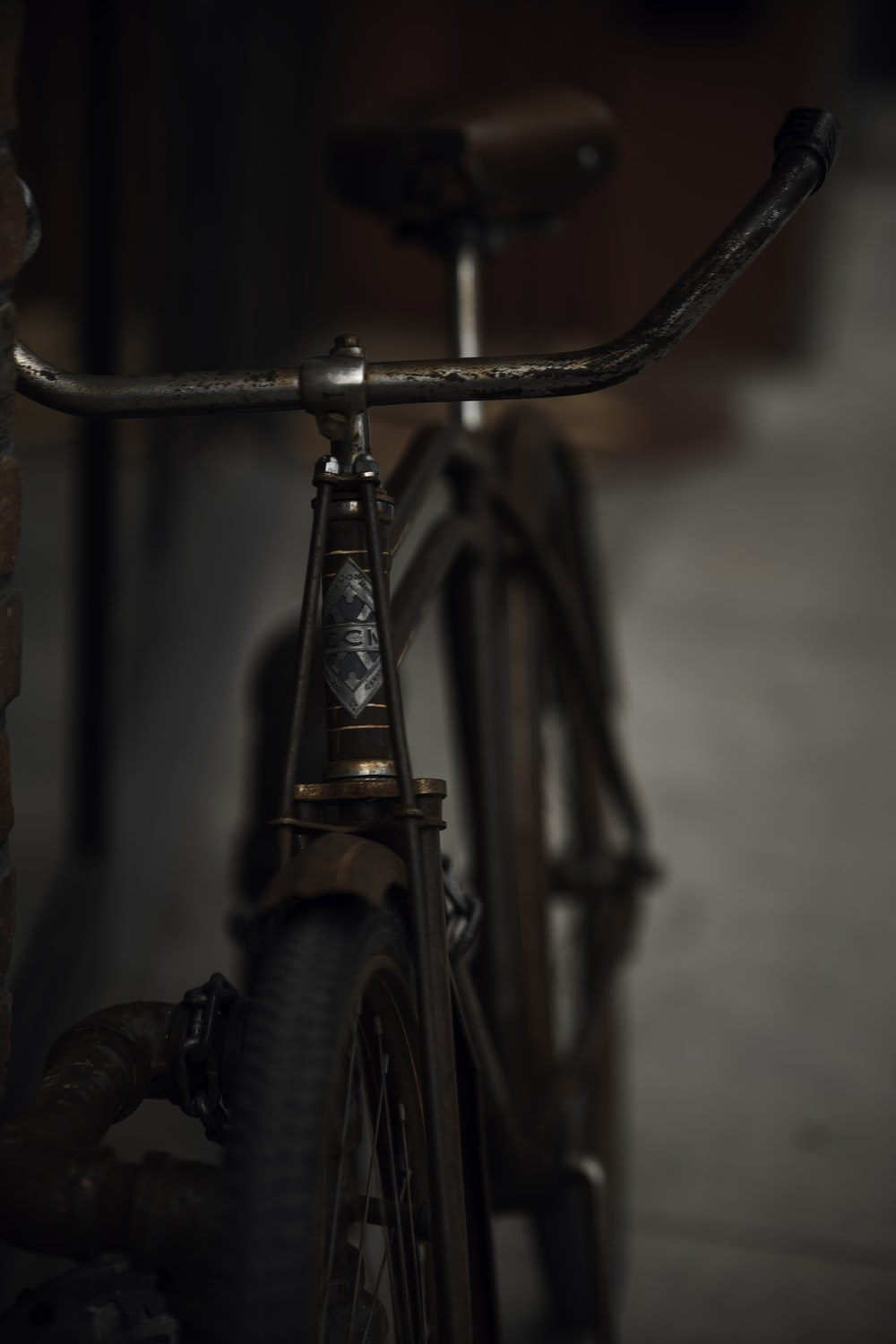 black bicycle with gold handle bar