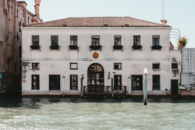 Venice white and brown concrete building near body of water during daytime