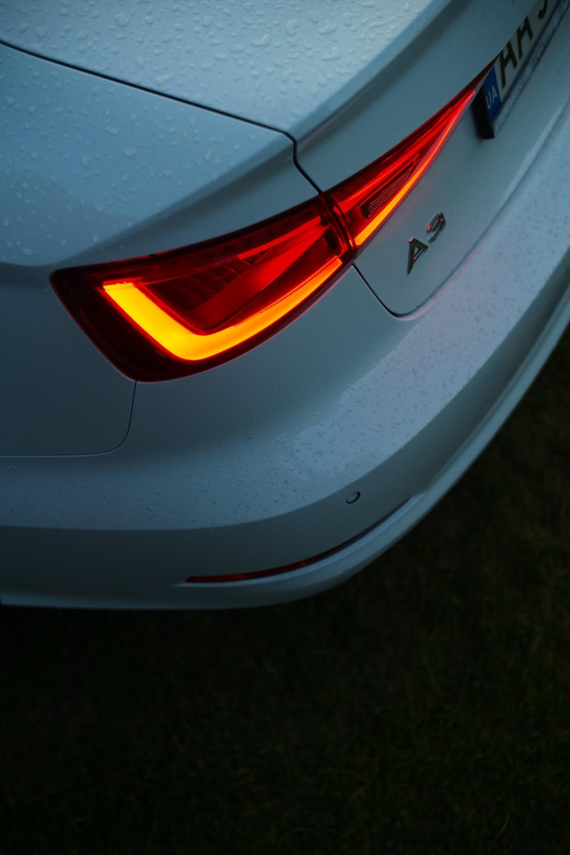 silver car with orange light