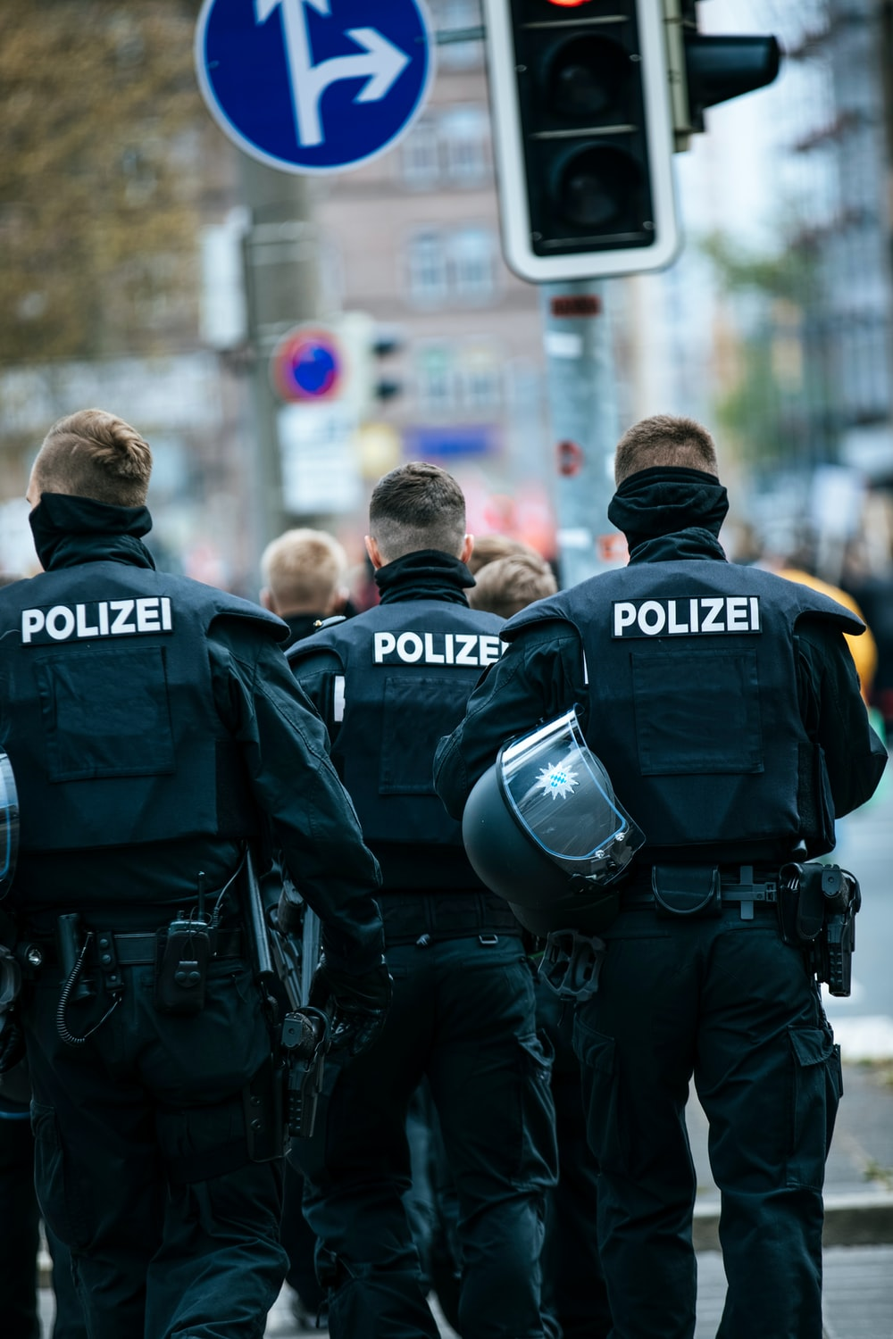 police men in black and blue police uniform standing on street during daytime