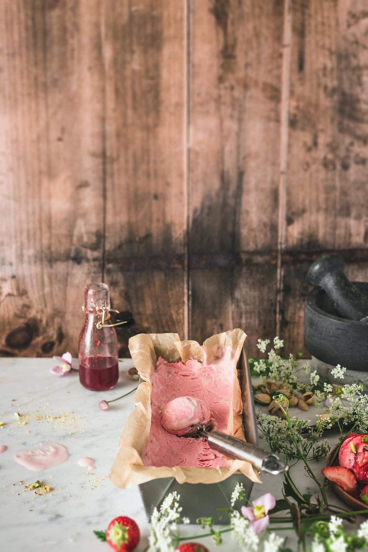 brown wooden chopping board beside clear glass bottle