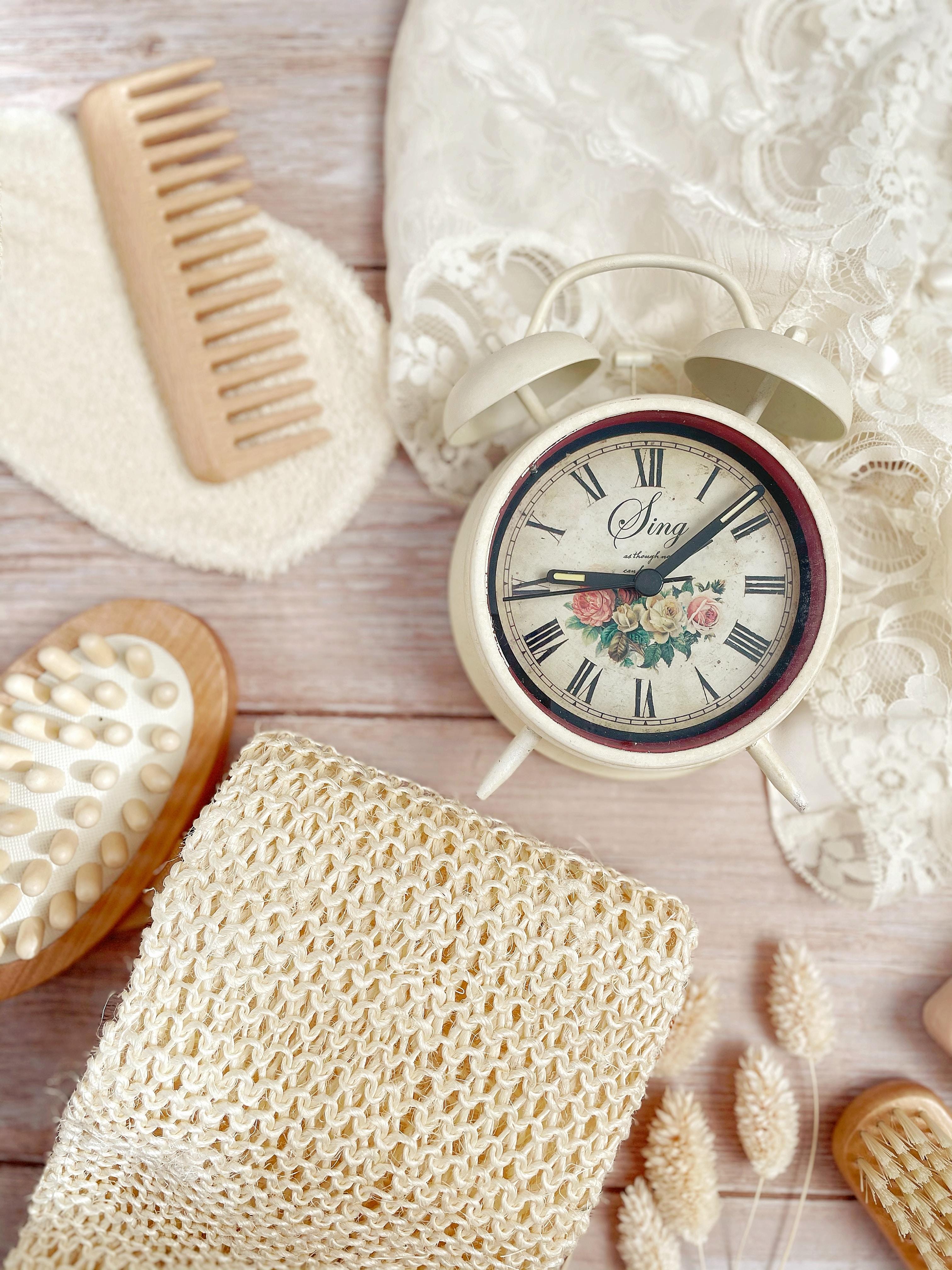 white round analog wall clock at 10 10
