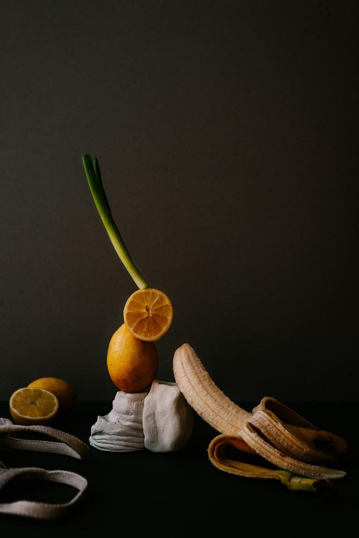 sliced lemon fruit on brown wooden chopping board