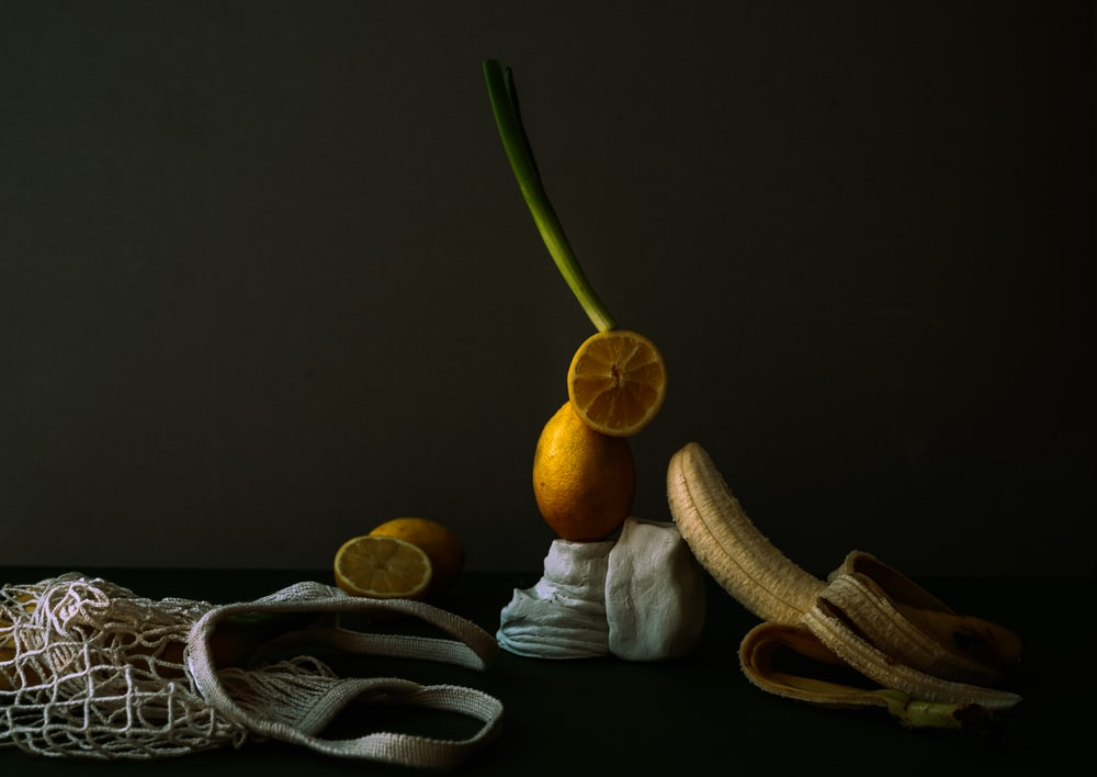 yellow banana fruit on black table