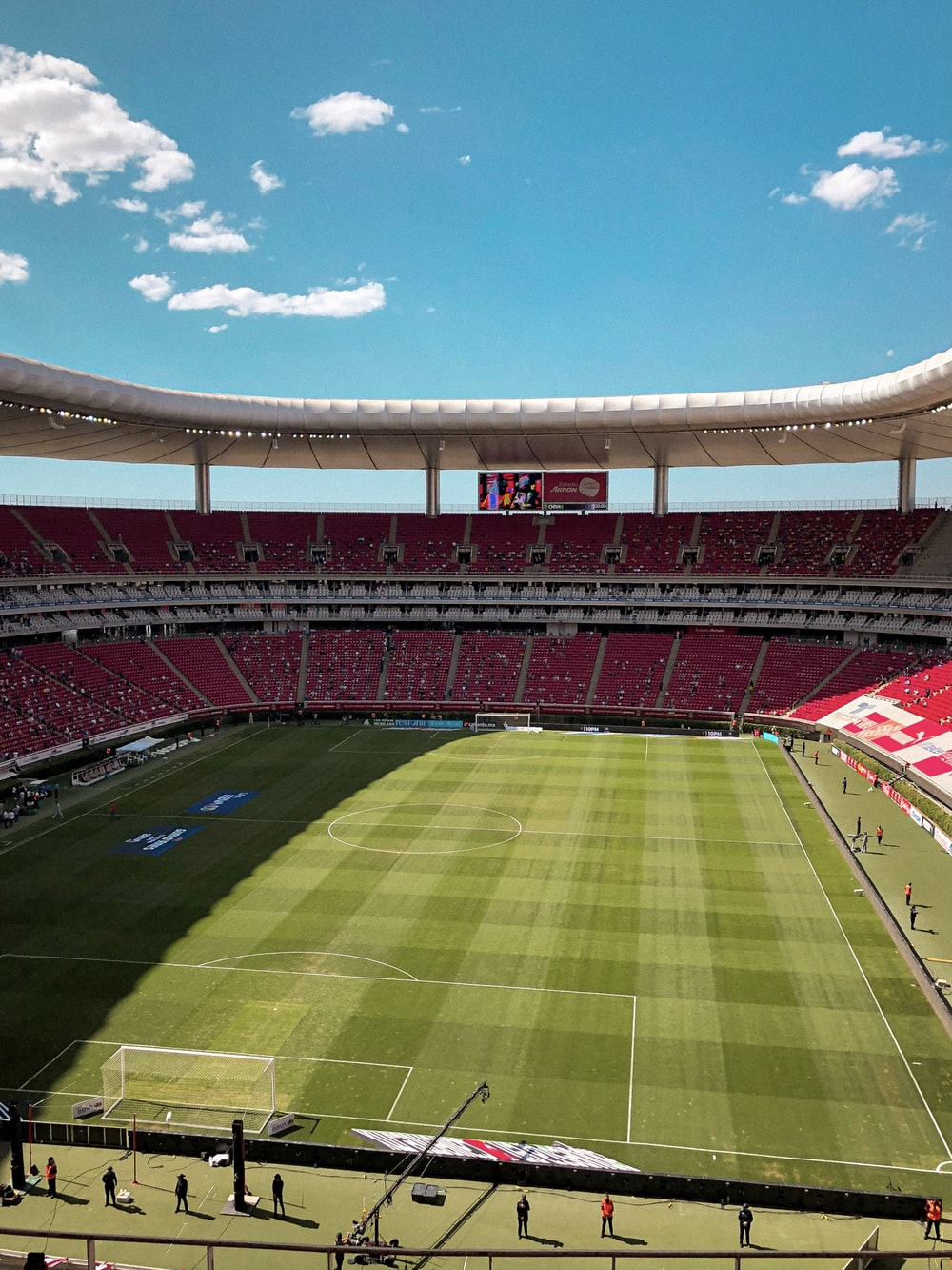 green and brown football stadium under blue sky during daytime