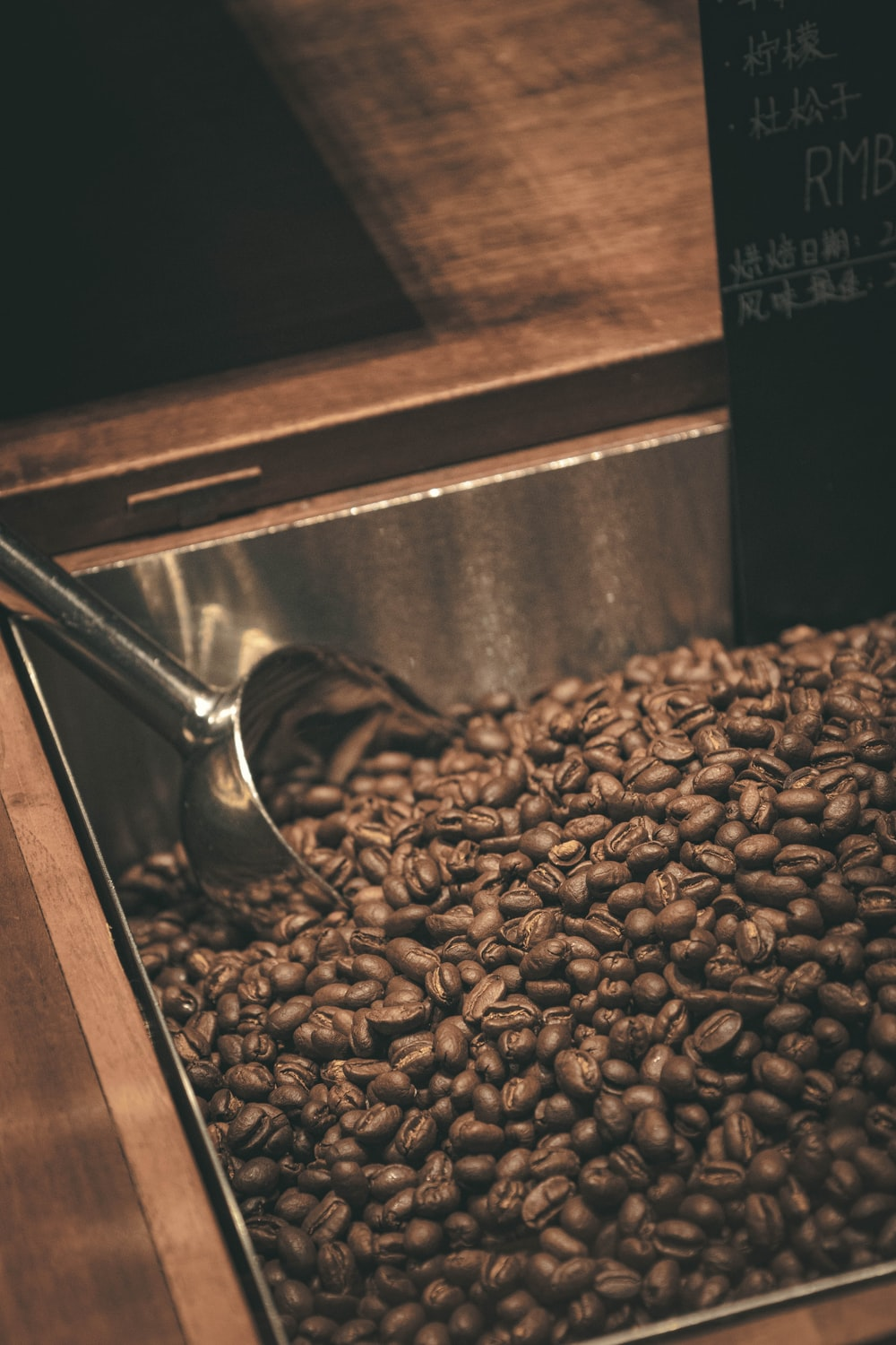 coffee beans on stainless steel cup