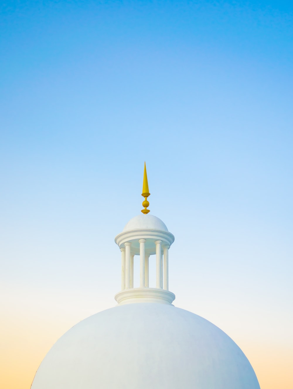 white dome building under blue sky during daytime