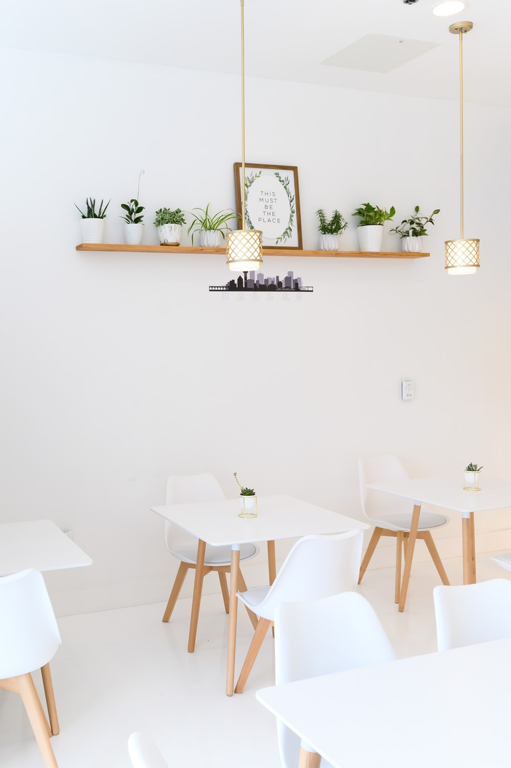 white table with chairs and table cloth