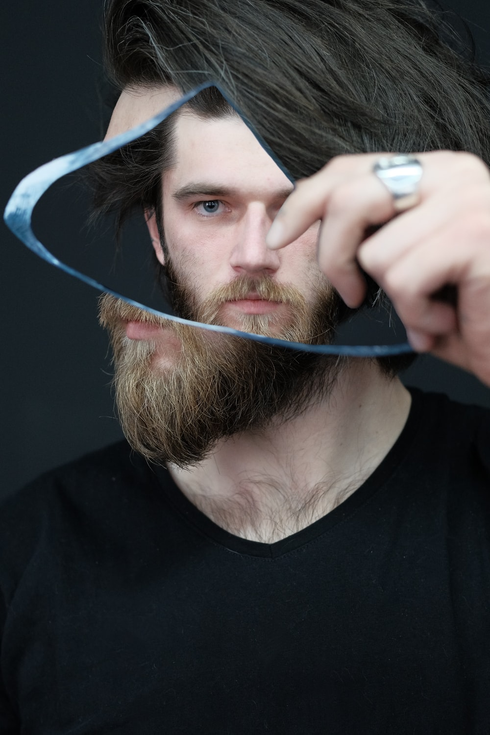 man in black crew neck shirt holding blue coated wire