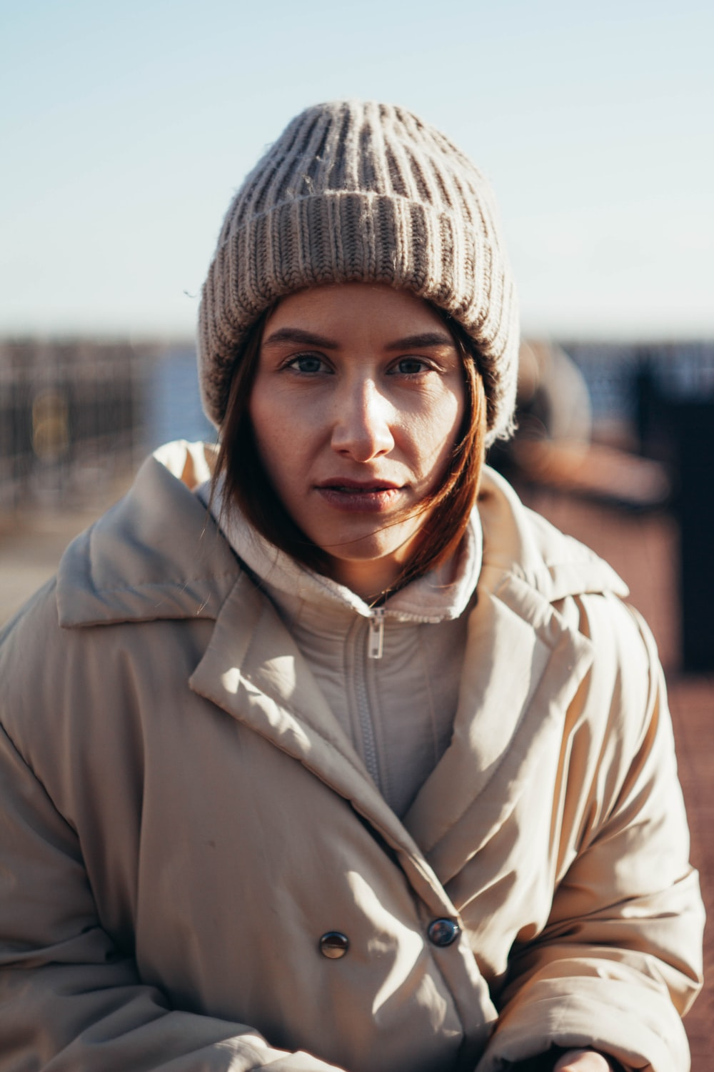 woman in gray knit cap and white zip up jacket
