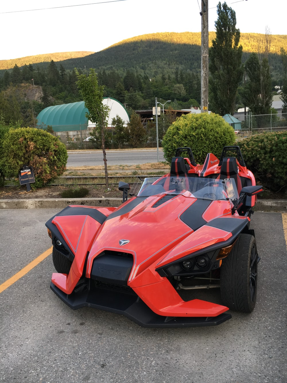 red and black lamborghini aventador on road during daytime