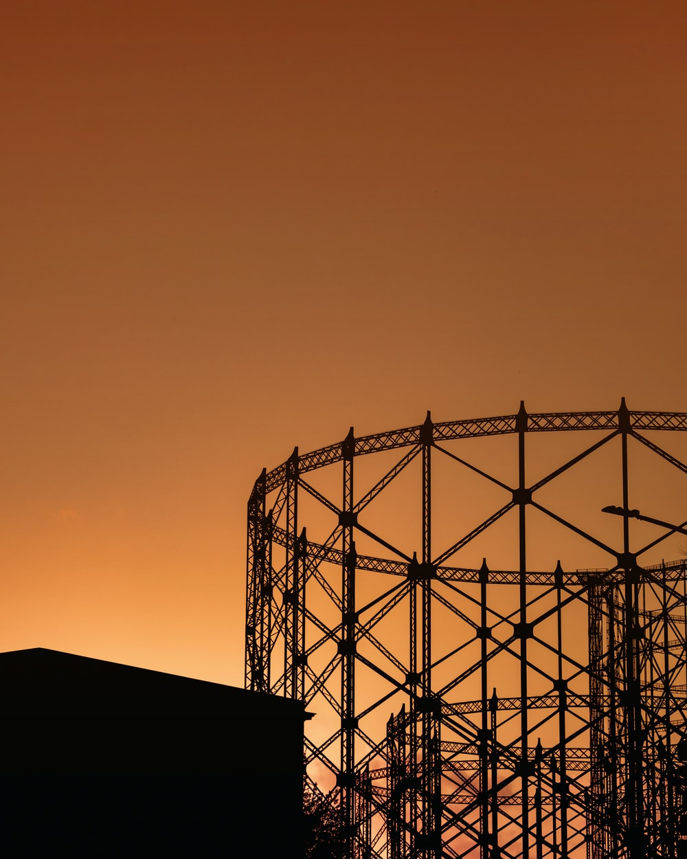 silhouette of metal tower during sunset