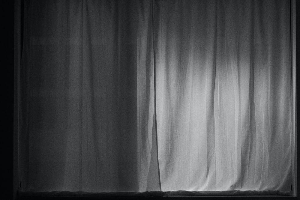 white window curtain in grayscale