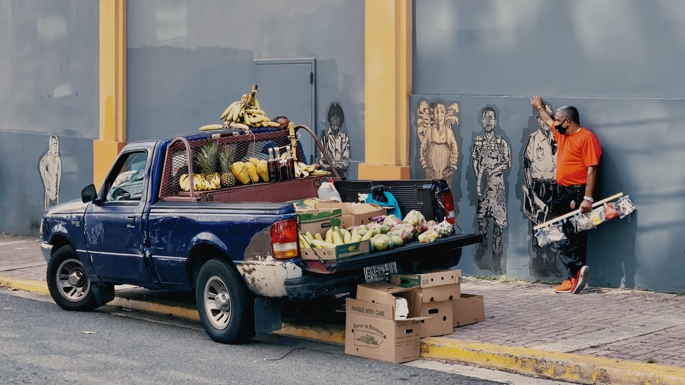 black and white single cab pickup truck with fruits and vegetables