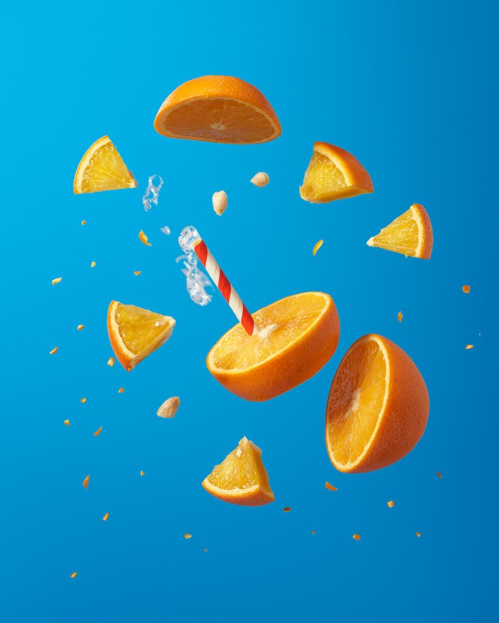 sliced orange fruit on blue surface