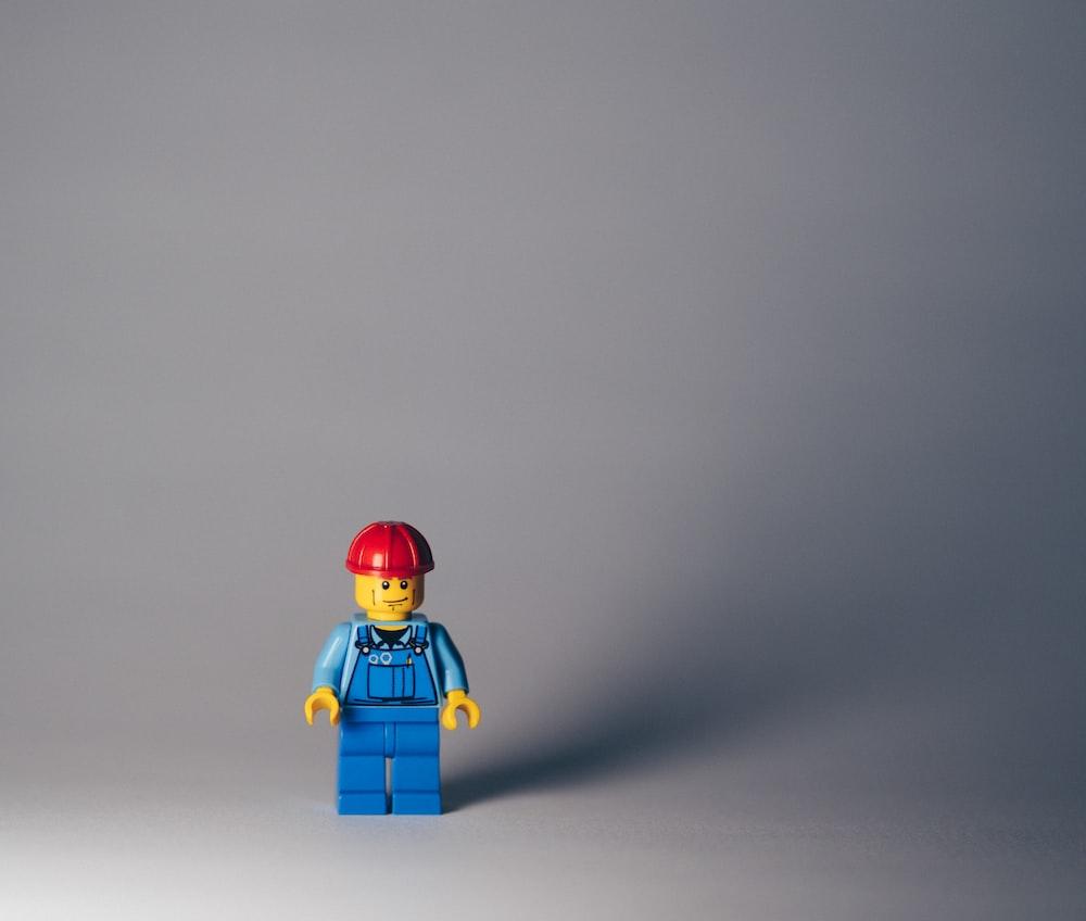lego minifig on white surface